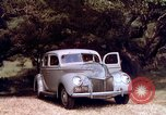 Image of People visiting a forest in their 1939 Ford car United States USA, 1939, second 40 stock footage video 65675051552