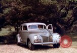 Image of People visiting a forest in their 1939 Ford car United States USA, 1939, second 41 stock footage video 65675051552