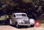 Image of People visiting a forest in their 1939 Ford car United States USA, 1939, second 43 stock footage video 65675051552