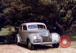 Image of People visiting a forest in their 1939 Ford car United States USA, 1939, second 46 stock footage video 65675051552