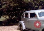 Image of People visiting a forest in their 1939 Ford car United States USA, 1939, second 49 stock footage video 65675051552