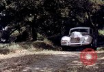 Image of People visiting a forest in their 1939 Ford car United States USA, 1939, second 61 stock footage video 65675051552