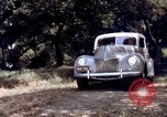Image of People visiting a forest in their 1939 Ford car United States USA, 1939, second 62 stock footage video 65675051552