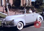 Image of Parents give daughter keys to a new Ford convertible United States USA, 1939, second 25 stock footage video 65675051553