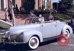 Image of Parents give daughter keys to a new Ford convertible United States USA, 1939, second 26 stock footage video 65675051553