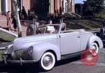 Image of Parents give daughter keys to a new Ford convertible United States USA, 1939, second 27 stock footage video 65675051553