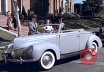 Image of Parents give daughter keys to a new Ford convertible United States USA, 1939, second 28 stock footage video 65675051553