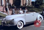 Image of Parents give daughter keys to a new Ford convertible United States USA, 1939, second 29 stock footage video 65675051553