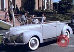 Image of Parents give daughter keys to a new Ford convertible United States USA, 1939, second 30 stock footage video 65675051553