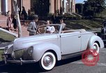 Image of Parents give daughter keys to a new Ford convertible United States USA, 1939, second 31 stock footage video 65675051553