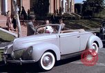 Image of Parents give daughter keys to a new Ford convertible United States USA, 1939, second 32 stock footage video 65675051553