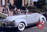 Image of Parents give daughter keys to a new Ford convertible United States USA, 1939, second 35 stock footage video 65675051553