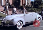 Image of Parents give daughter keys to a new Ford convertible United States USA, 1939, second 36 stock footage video 65675051553