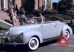Image of Parents give daughter keys to a new Ford convertible United States USA, 1939, second 37 stock footage video 65675051553