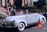 Image of Parents give daughter keys to a new Ford convertible United States USA, 1939, second 38 stock footage video 65675051553