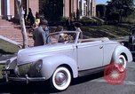 Image of Parents give daughter keys to a new Ford convertible United States USA, 1939, second 39 stock footage video 65675051553