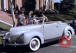 Image of Parents give daughter keys to a new Ford convertible United States USA, 1939, second 41 stock footage video 65675051553