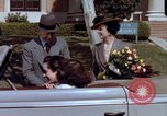 Image of Parents give daughter keys to a new Ford convertible United States USA, 1939, second 48 stock footage video 65675051553