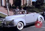 Image of Parents give daughter keys to a new Ford convertible United States USA, 1939, second 53 stock footage video 65675051553