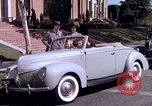 Image of Parents give daughter keys to a new Ford convertible United States USA, 1939, second 54 stock footage video 65675051553