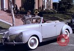 Image of Parents give daughter keys to a new Ford convertible United States USA, 1939, second 55 stock footage video 65675051553