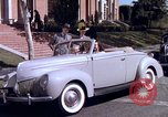 Image of Parents give daughter keys to a new Ford convertible United States USA, 1939, second 56 stock footage video 65675051553