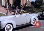 Image of Parents give daughter keys to a new Ford convertible United States USA, 1939, second 57 stock footage video 65675051553