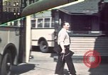 Image of buses in garage United States USA, 1937, second 1 stock footage video 65675051568