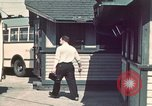 Image of buses in garage United States USA, 1937, second 3 stock footage video 65675051568