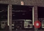 Image of buses in garage United States USA, 1937, second 14 stock footage video 65675051568