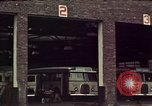 Image of buses in garage United States USA, 1937, second 15 stock footage video 65675051568