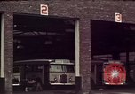 Image of buses in garage United States USA, 1937, second 16 stock footage video 65675051568