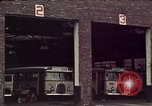 Image of buses in garage United States USA, 1937, second 17 stock footage video 65675051568