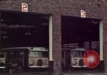 Image of buses in garage United States USA, 1937, second 18 stock footage video 65675051568