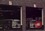 Image of buses in garage United States USA, 1937, second 19 stock footage video 65675051568