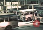 Image of buses in garage United States USA, 1937, second 20 stock footage video 65675051568