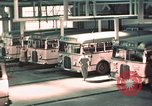 Image of buses in garage United States USA, 1937, second 21 stock footage video 65675051568