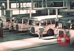 Image of buses in garage United States USA, 1937, second 22 stock footage video 65675051568