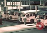 Image of buses in garage United States USA, 1937, second 23 stock footage video 65675051568