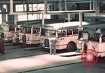 Image of buses in garage United States USA, 1937, second 24 stock footage video 65675051568