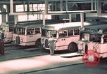 Image of buses in garage United States USA, 1937, second 25 stock footage video 65675051568