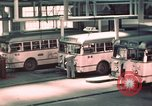 Image of buses in garage United States USA, 1937, second 26 stock footage video 65675051568