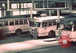 Image of buses in garage United States USA, 1937, second 27 stock footage video 65675051568