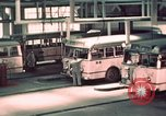 Image of buses in garage United States USA, 1937, second 28 stock footage video 65675051568