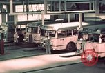 Image of buses in garage United States USA, 1937, second 29 stock footage video 65675051568
