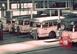 Image of buses in garage United States USA, 1937, second 30 stock footage video 65675051568