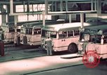 Image of buses in garage United States USA, 1937, second 31 stock footage video 65675051568