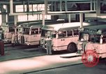 Image of buses in garage United States USA, 1937, second 34 stock footage video 65675051568