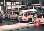 Image of buses in garage United States USA, 1937, second 35 stock footage video 65675051568