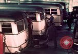 Image of buses in garage United States USA, 1937, second 37 stock footage video 65675051568